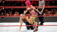 Asuka pulling on Dana Brooke hair
