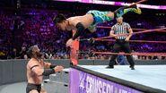 Tozawa dive onto Neville
