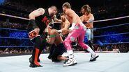 AJ Styles Dolph Ziggler Kevin Owens and Sami Zayn attacking John Cena