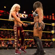 Liv Morgan shaking hand with Ember Moon