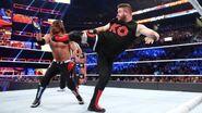 Owens superkick Styles