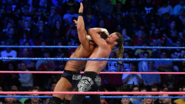 Dolph-Ziggler putting Roode in a sleeper hold
