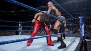 Orton holding Nakamura