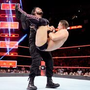Reigns quickly battles back by driving his nemesis into the canvas