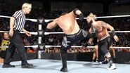 Styles kicks Enzo at the chest