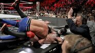 AJ Styles tackles Finn Balor over the announce table