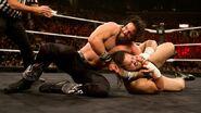 Elias-Samson putting Bull-Dempsey in a headlock