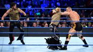 Fandango and Tyler Breeze attacking Mojo Rawly