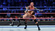 Orton strike with a clothesline at Sami Zayn