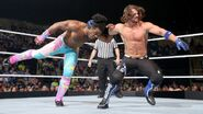 AJ Styles against Xavier Woods