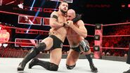 Balor grappling Cesaro