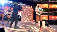 Sensing an opportunity Carmella bolts to the ring