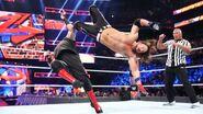 AJ-Styles hit dropkick on Kevin-Owens