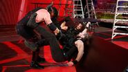 Kane double chokeslam Ambrose and Rollins