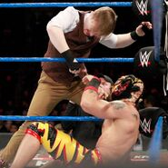 Jack Gallagher attempts a cheap shot from the apron
