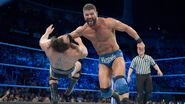 Roode flattens Rusev with a clothesline