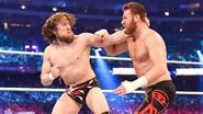 Bryan fighting off Sami Zayn