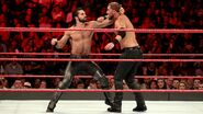 Seth-Rollins punches Axel