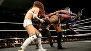 Kairi Sane and Peyton Royce Ember Moon and Nikki Cross battle in a Fatal 4-Way