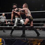 Black battles Almas at ringside