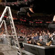 Ambrose and Rollins launch themselves off the ladders to take out Kane and Strowman
