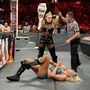Natalya is disqualified after savagely attacking Charlotte
