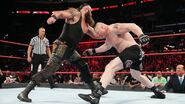 Strowman attacking Lesnar