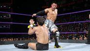 Akira-Tozawa deliver a kick to Dar