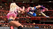 Asuka sends a dropkick at Bliss