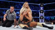 Carmella putting Charlotte down