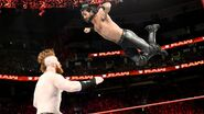 Sheamus hit from above by Rollins