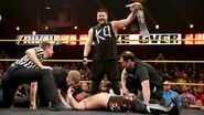 Kevin-Owens stands-victorious-over Sami-Zayn