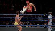 Metalik jumps with a dropkick on Gulak
