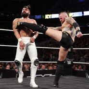 Aleister kicked to Andrade