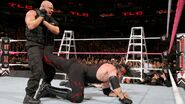 Angle putting Kane in the ankle lock