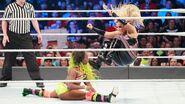 Natalya dropkick Naomi
