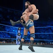 Rusev puts through with a spinebuster