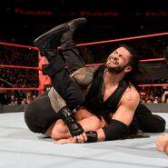 Roman Reigns retain his title