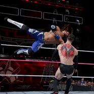 Styles hit Balor with the forearm