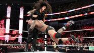 Batista spear Roman Reigns