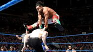 Xavier Woods leap over English