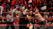 Bo-Dallas and Curtis-Axel attacking Roman-Reigns