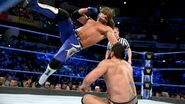 Styles deliver a forearm to Rusev