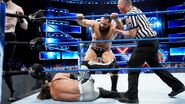 Aiden English and Rusev attack down AJ Styles