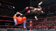 Apollo dropkick Hawkins