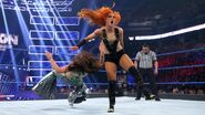 Becky-Lynch clotheline Mickie-James