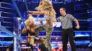 Carmella stomps Charlotte in the corner