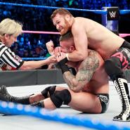 Zayn traps Orton in a headlock