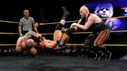 Eric Young and Alexander Wolfe double team on Roderick Strong