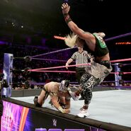 Amore tries kicks Kalisto off the ring apron